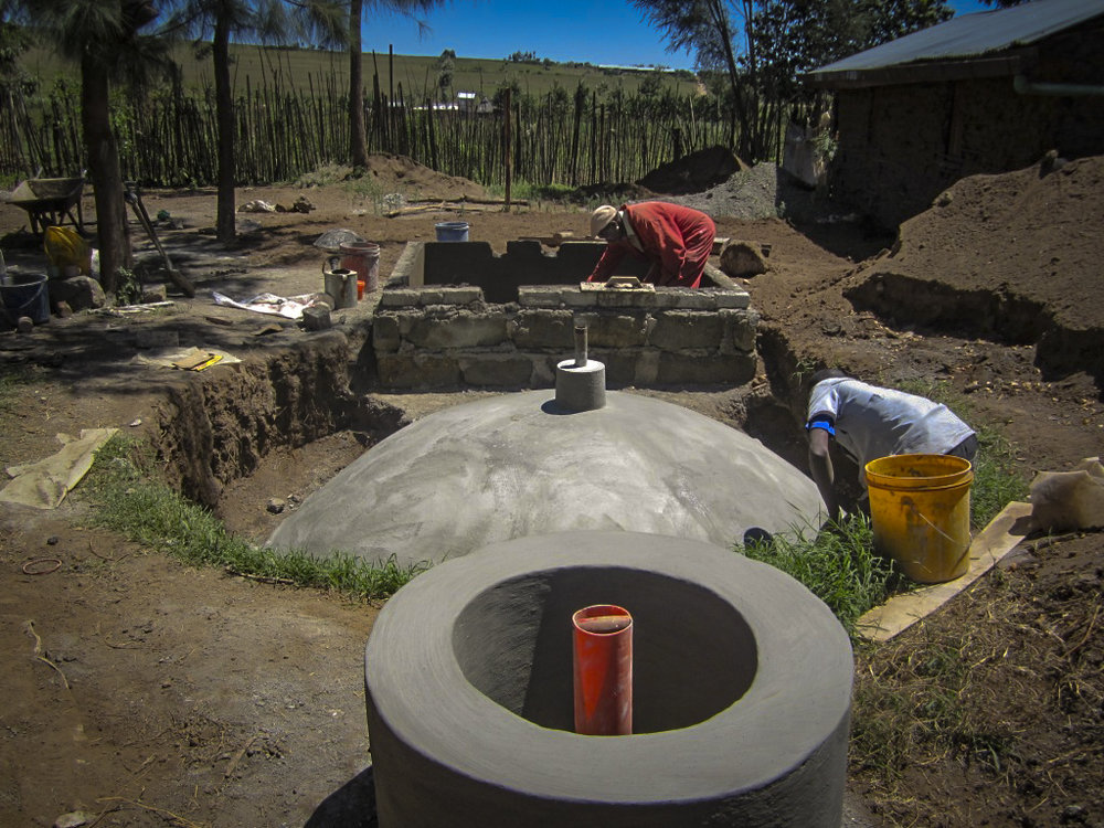The fixed-dome biogas digester under construction