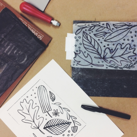 We started with a drawing, transferred it to carbon paper, then go our linoleum.