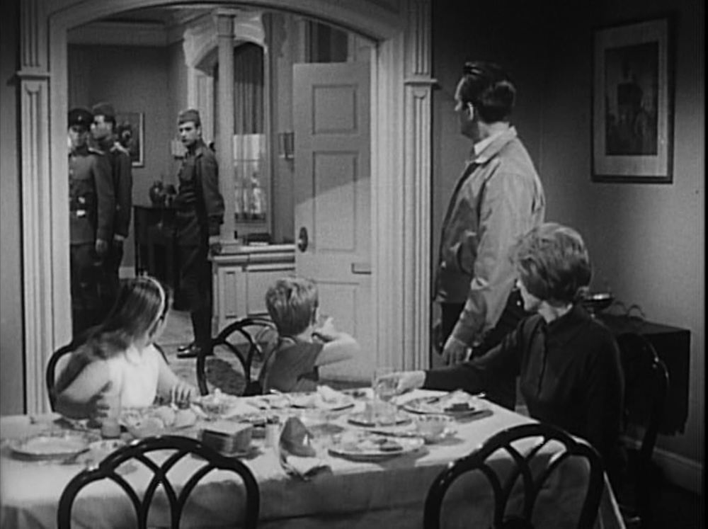 Jerry is interrupted at home by a group of soldiers entering his home