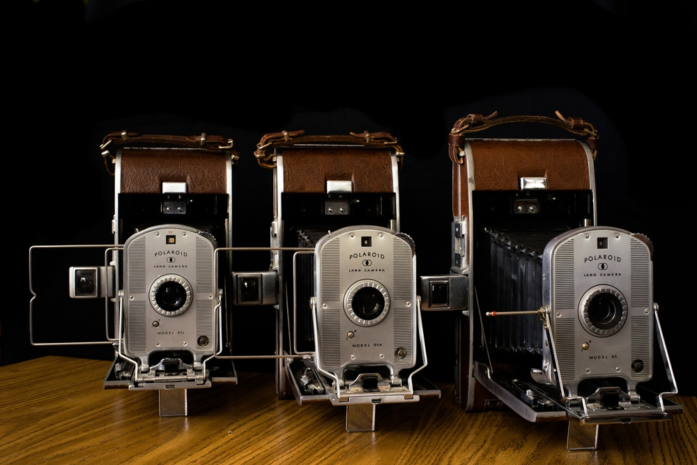 Each of the three Model 95 Land Cameras. (Left to right: 95B, 95A, 95). Each showing slight differences, most notably the view finder. Photo: Trey Takahashi