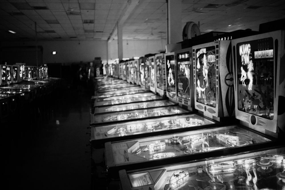 Rows of Pinball Machines, both new and old, line the walls of the Pinball Hall of Fame. Photo: Trey Takahashi