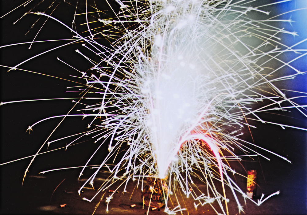 Image 1: Firework shot with a Canon AE-1 w/ a light leak. The blue color shift and overexposure comes from a leaking seal.