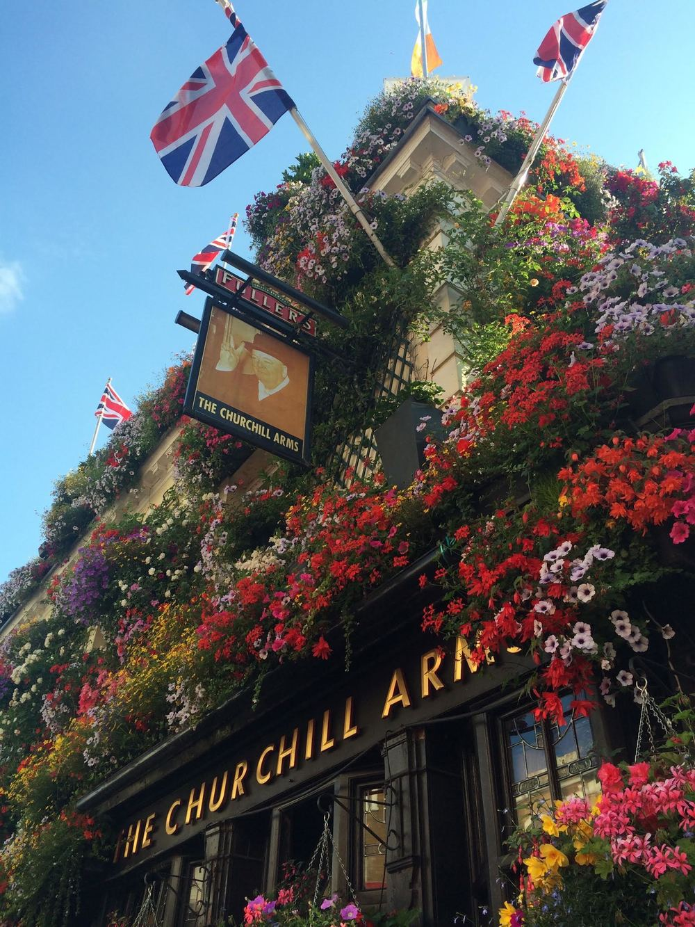 A contemporary capture - The Churchill Arms pub, situated near Notting Hill. Takes two hours to water all the plants inside & out of the place.   Photo by Celene Barrera