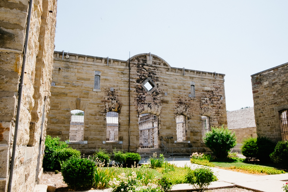 The walls of the mess hall and chapel still stand, with the charred marks of the fire visible.
