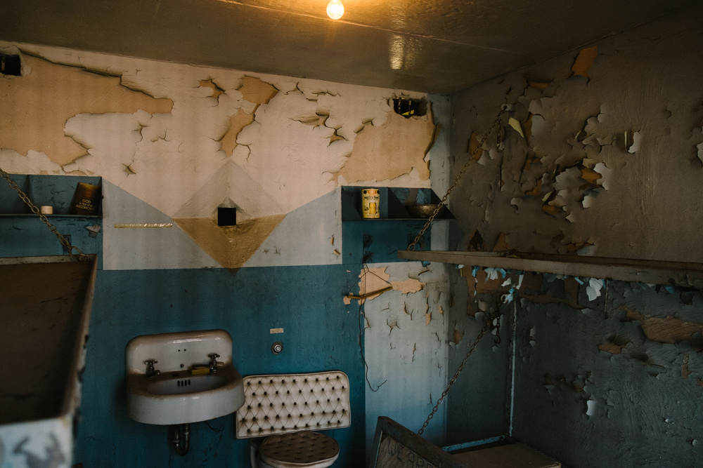 Many of the jail cells are left with paint peeling and the interior decaying with age.
