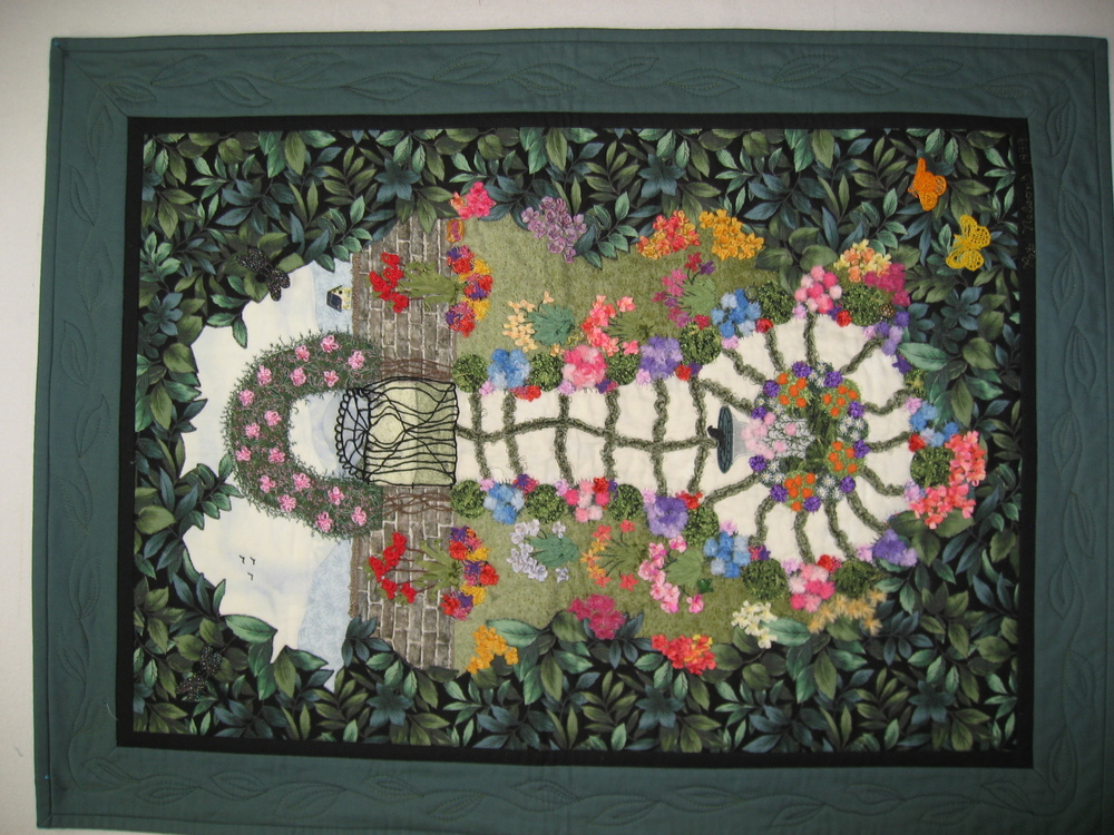 "Bobbin work, machine ribbon/yarn embroidery, threadlaceand machine embroidery and is titled ""Shakespeares' Garden"""
