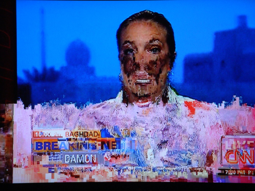 This odd photo was taken during a thunderstorm when the TV connection was off again, on again. The resulting image is one of discordancy. We trust news anchors (don't we?) and yet this one is less than reliable.