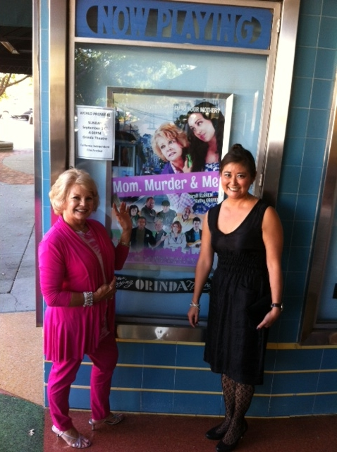 Kathy with writer-director heather Donnell at the beautiful Orinda Theatre   in front of the Mom, Murder and Me poster awaiting start of film's premier showing