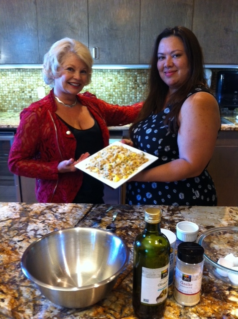Host Kathy Garver with guest Veronica and her  wok-cooked chicken and rice.