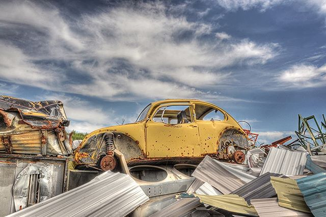 This is Bumble bee 🐝  It's not to often I come across Volkswagen beetles, I found this one at a junk yard! I was having an off day, kinda of in a rut with my photography. My husband Shane was like you should take a picture of that! He pointed to the bug on the pile of scrap metal! I wasn't feeling it but he kept pushing me to do it.  So I walked up to it  and took the picture really quickly without any framing or thought and you know what? It was the best photo I had taken that day!!! I love the way the blue sky complements the yellow bug! You know sometimes I think we over think things! I think that was my problem that day! Do you ever get stuck in a rut? How do get out of them?