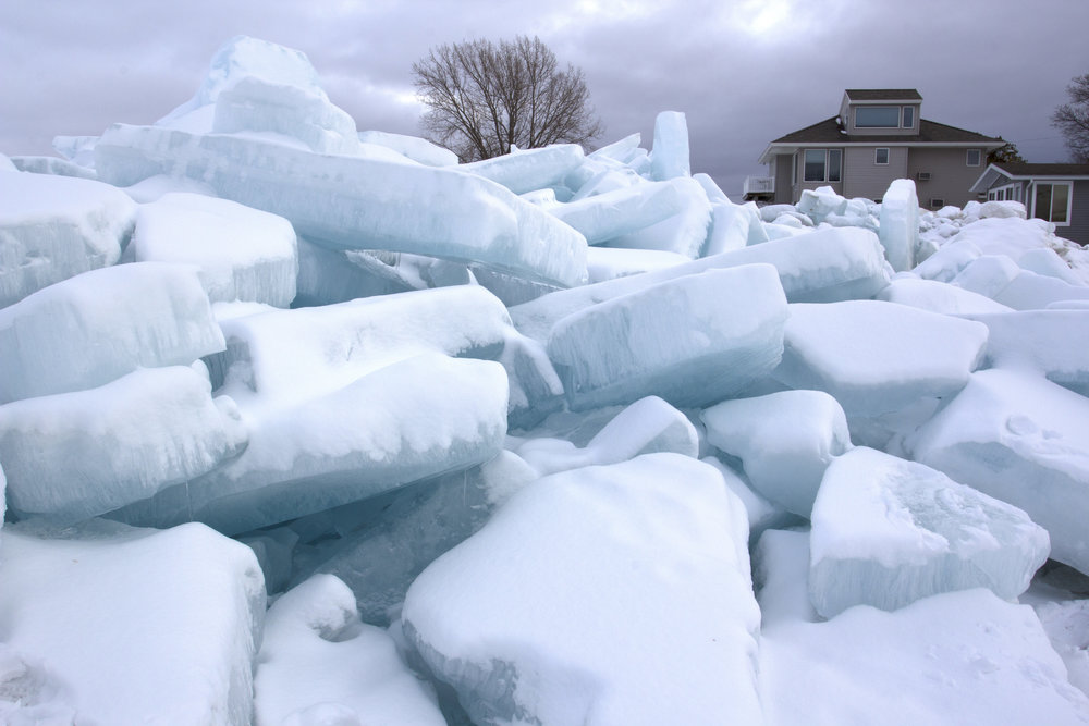 As the piles of ice grew they were forced right up to the houses on shore.