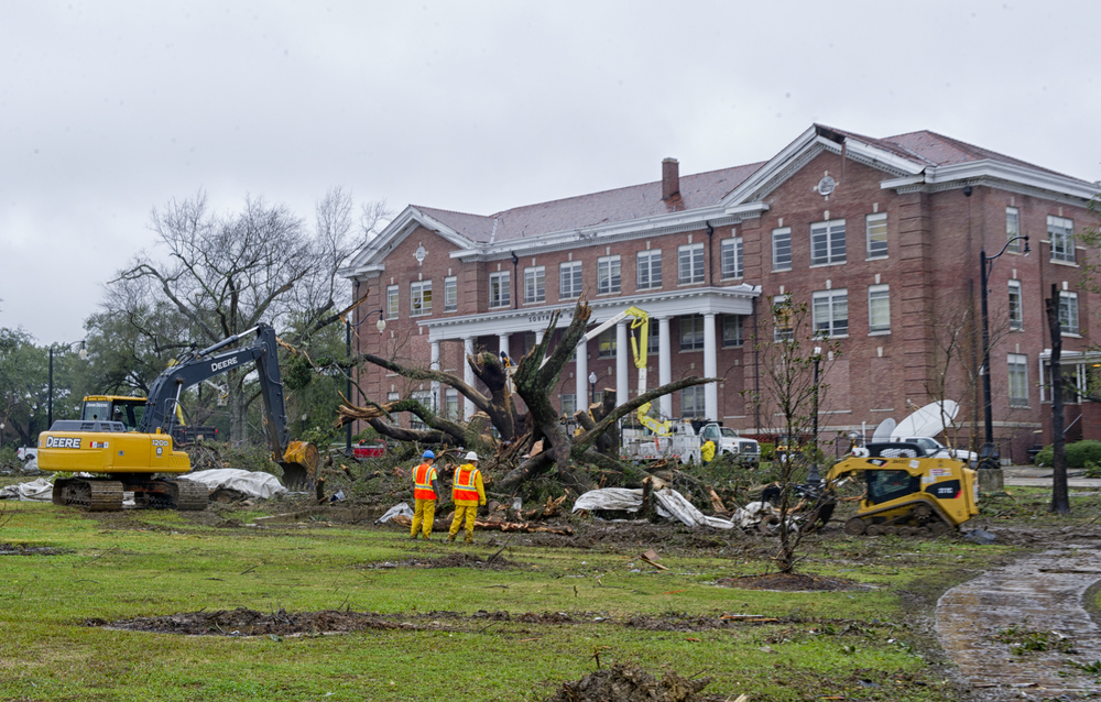 Crews work to remove tree damage to the front lawn of Southern Hall after the tornado at The University of Southern Mississippi. February 10, 2013, Hattiesburg, Miss.
