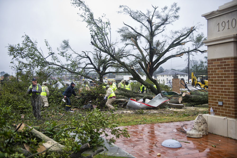 Crews work to remove tornado debris from The University of Southern Mississippi gateway. February 11, 2013, Hattiesburg, Miss.