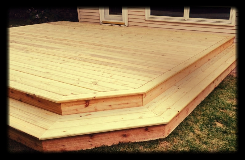 Bill's deck is a pressure-treated deck with picture framing and cedar trim.