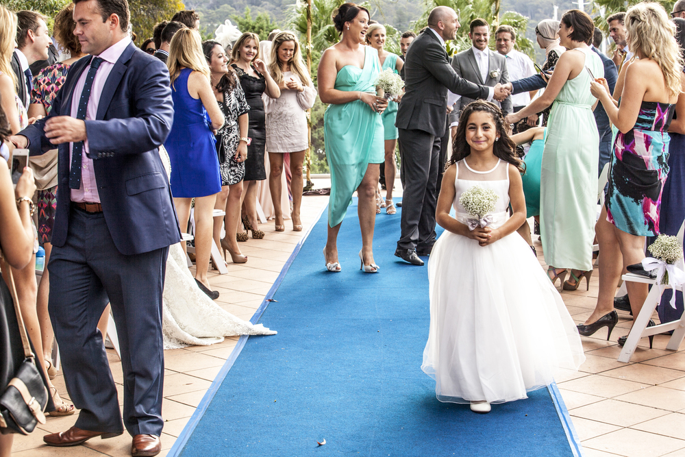 The flower girl could not stop smiling