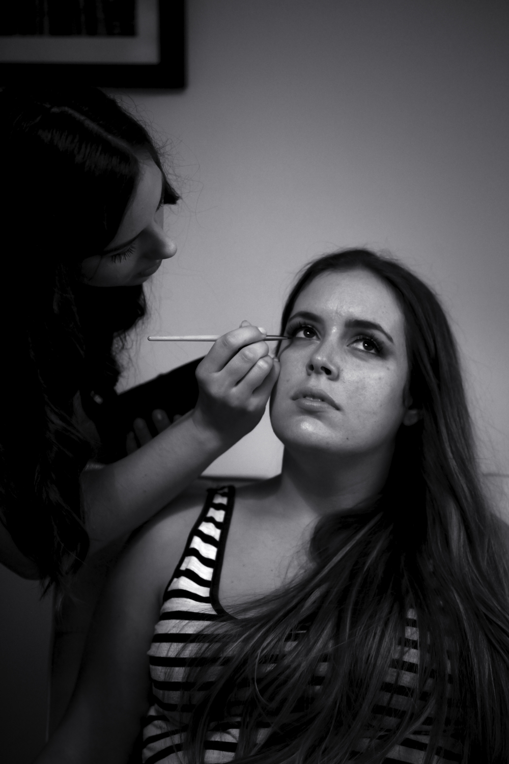 Candid moment: best friend, bridesmaid, witness and make-up artist Adna puts the finishing touches on bride Cassi.