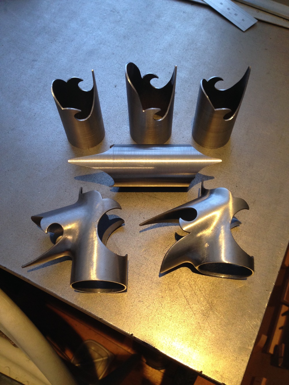Hand carved bi-laminate lugs