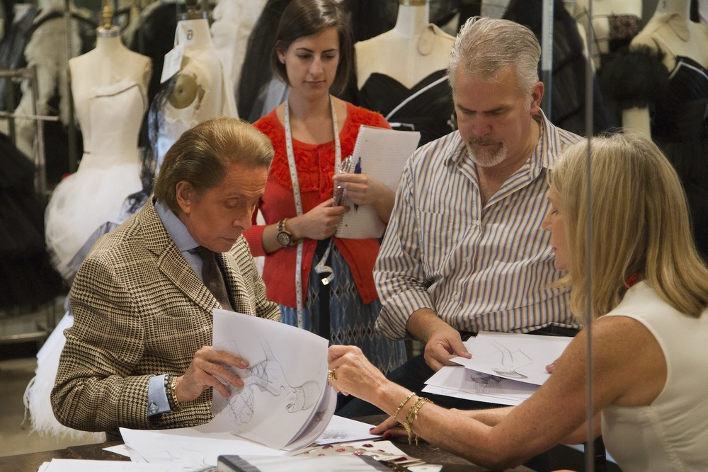 Valentino, Tracey, Marc Happel and Valentino assistant reviewing designs for New York City Ballet
