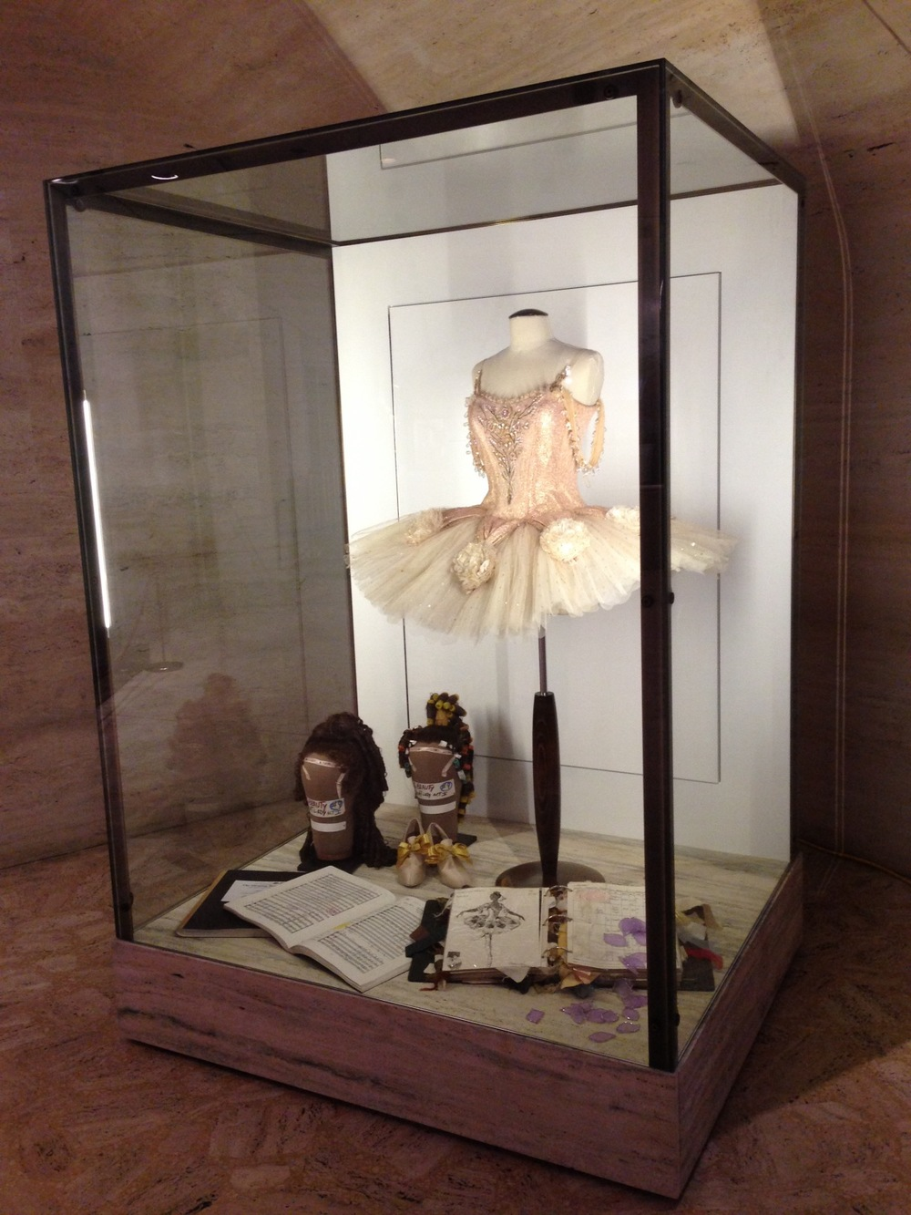 A costume display in the lobby of the Koch Theatre at Lincoln Center, designed to give patrons a closer look at costumes, wigs and accessories.