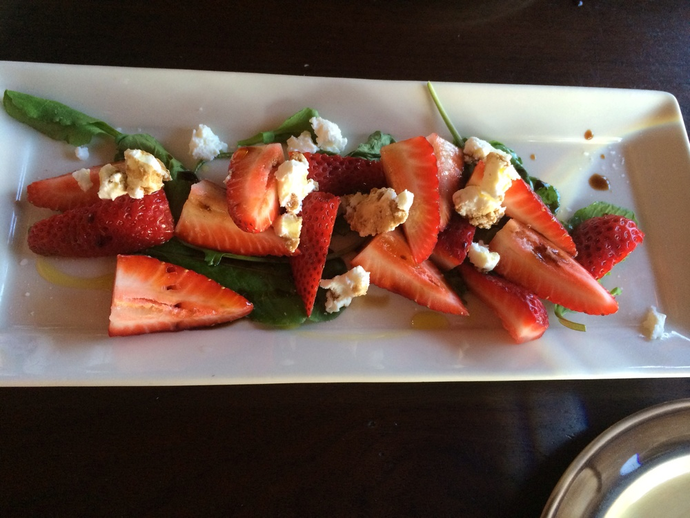 Strawberry salad with balsamic vinaigrette, arugula, and goat cheese