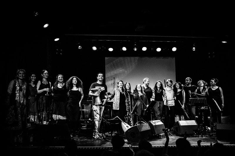 Facing a standing ovation with all the musicians who jammed with us. From left to right: Ranu, Zulal trio, Cynthia Zaven, Rony Barrak, Negar Bouban, Feruza Ochilova, Dima Orsho, Alex Morsey, Simin Tander, Bodek Janke, Nelly Markarian, Kinan Azmeh, Caroline Thon, Veronika Todorova.  photo by Andy Spyra