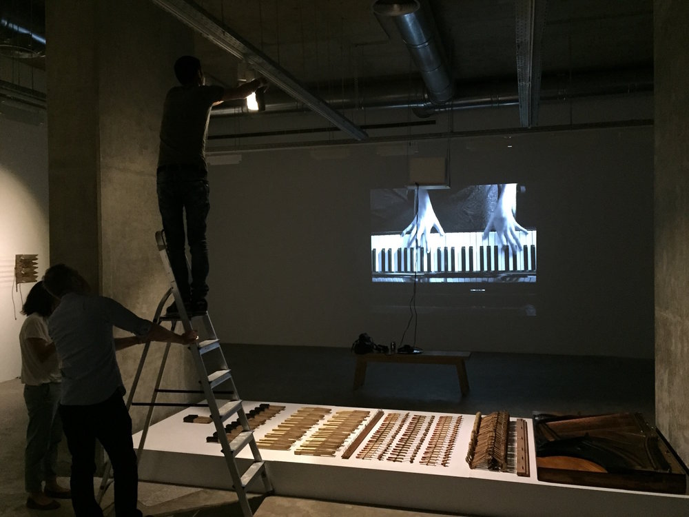 "Working the light on the dismantled piano, in front of Ziad Antar's video "" La Marche Turque"""