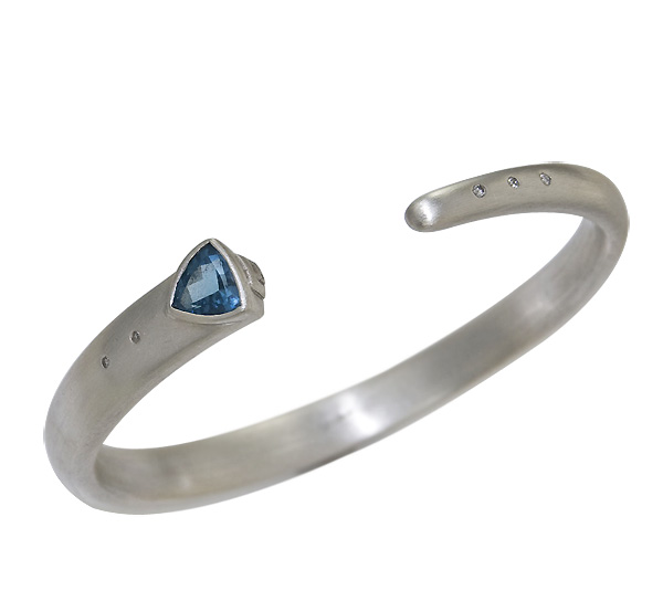 Bracelet with faceted Blue Topaz and Diamond accents set in solid Sterling Silver