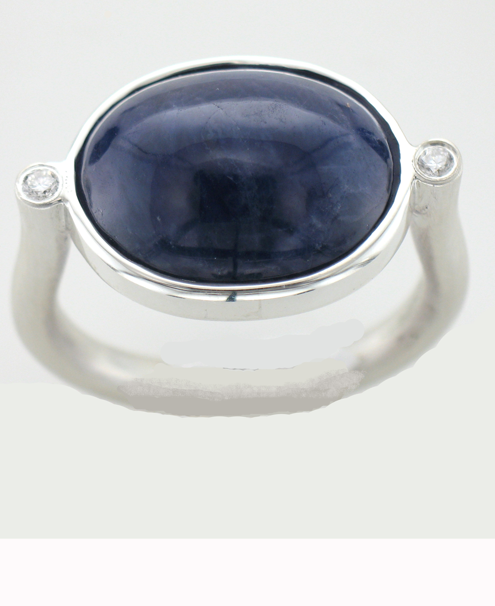 Sapphire Cabochon ring with Diamond accents set in brushed Sterling Silver