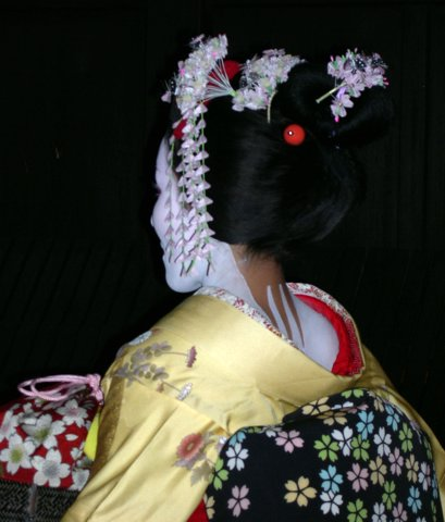 Geisha scurrying to her next appointment, Kyoto, Japan