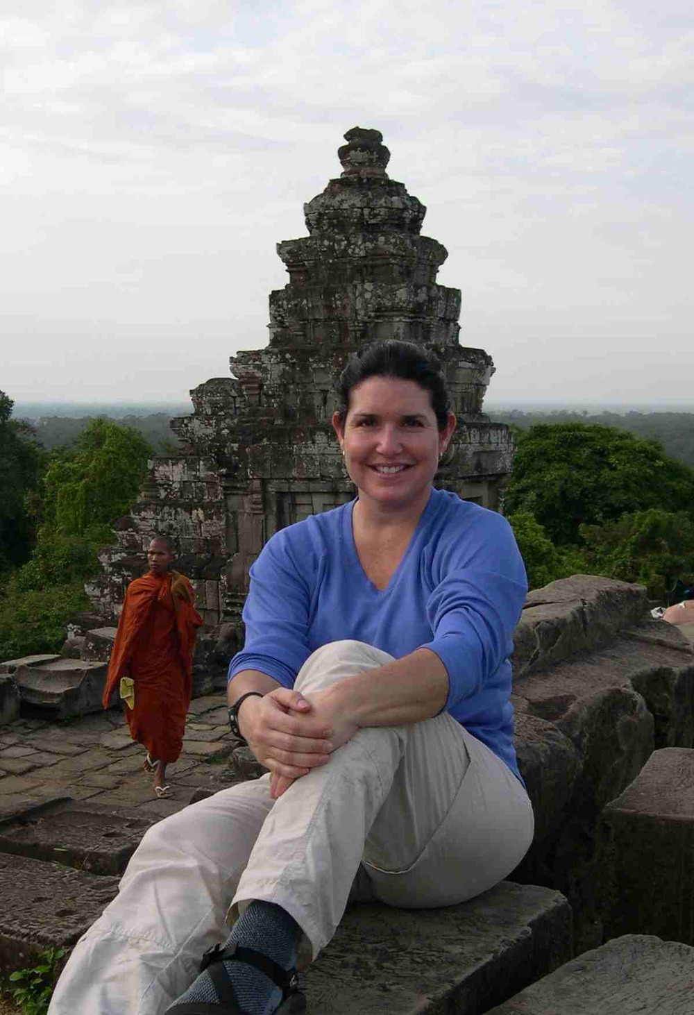 Perched atop a temple in Angkor Wat for sunset (the monk was an added bonus) Angkor Wat, Cambodia