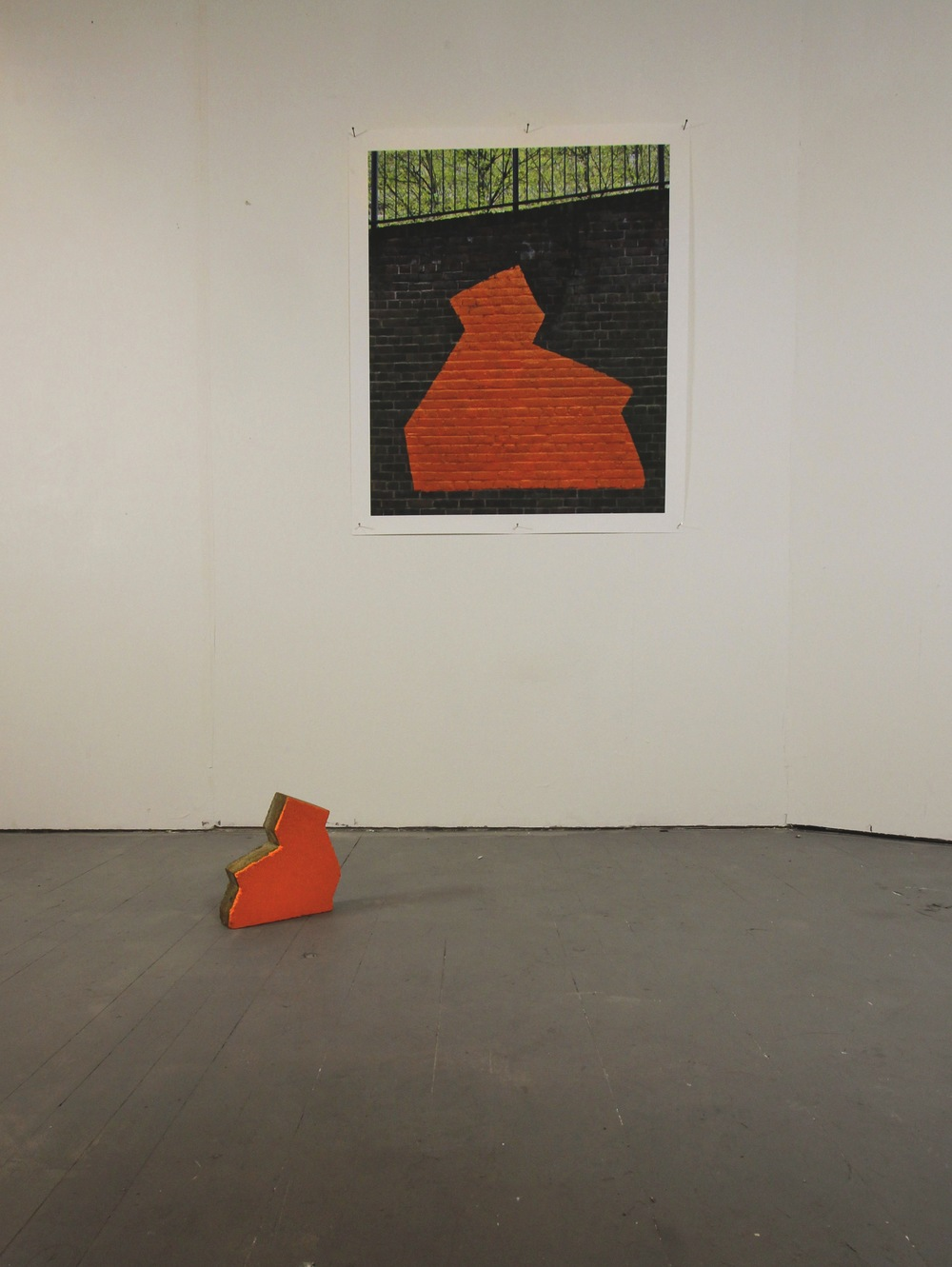 Phase One: Flame (installation view)                      Concrete shape found on the Heygate Estate, gloss paint, inkjet print on paper                   2013