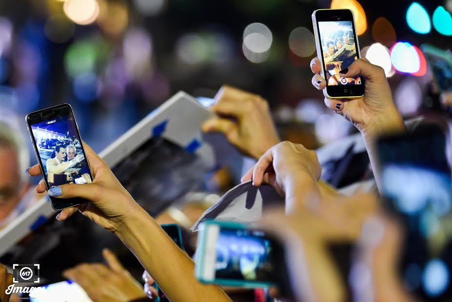 Fans swarmed Johnny Depp with cell phones in hand to take a photo of him.