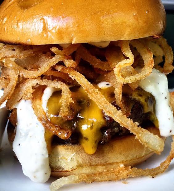 Chef Michael Schlow's famous Schlow Burger. Image via Tico