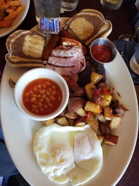 FULL IRISH BREAKFAST   two fried eggs, back rashers, bangers, grilled tomato, baked beans, sautéed mushrooms, black & white pudding, home fries, toast