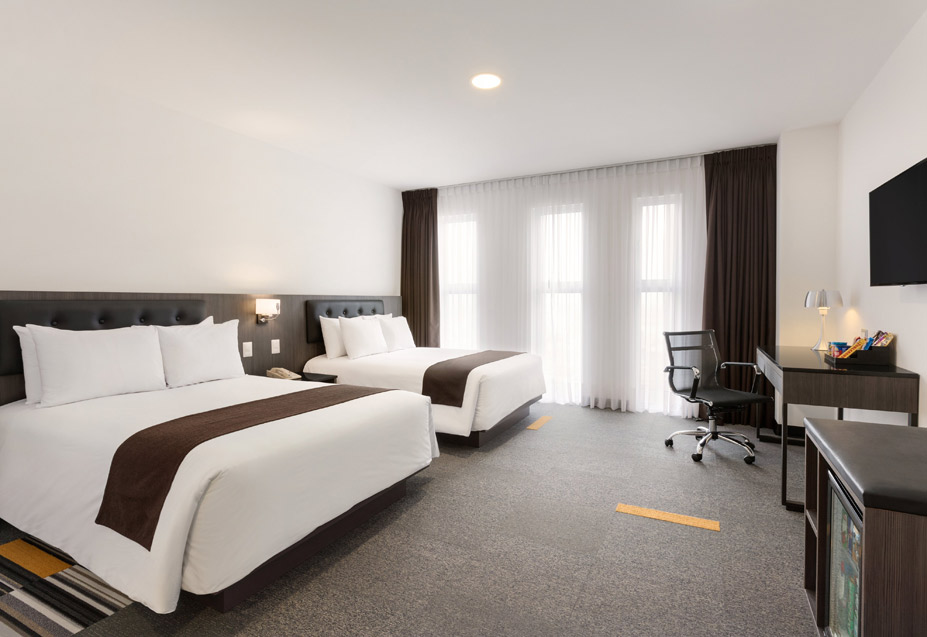 Wyndham Airport Hotel room interior.jpg