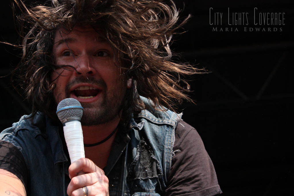 Adam Lazzara of  Taking Back Sunday  July 30th - Charlotte, NC Vans Warped Tour 2012    View more photos  here .     WEBSITE    COVERAGE    TWITTER    FACEBOOK