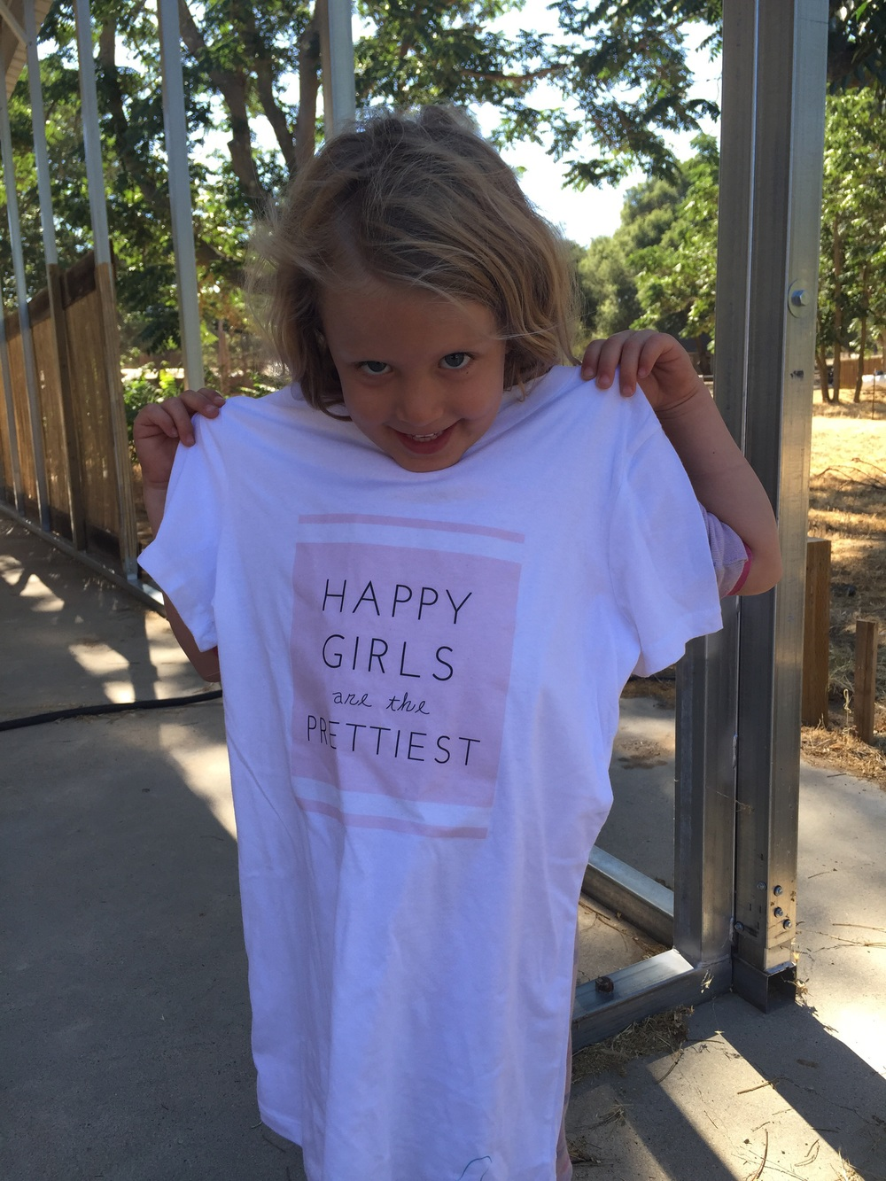 Iris and her limited edition BH tee.