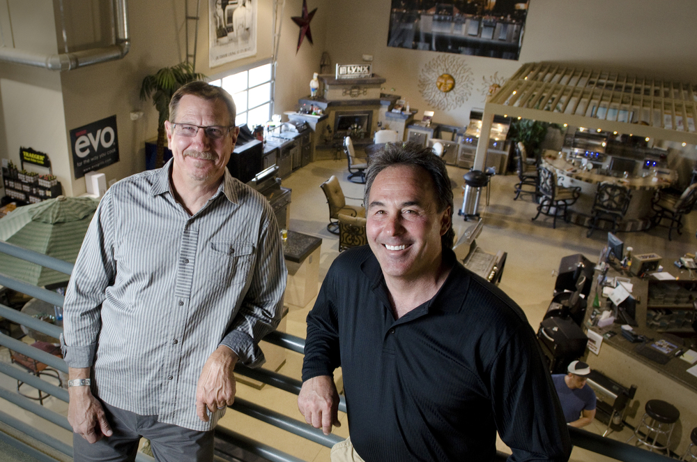 Owners of Nevada Outdoor Living, Scott Jones and Bill Reingruber (pictured left to right), pose for a portrait overlooking the showroom floor of their Henderson, Nevada store.