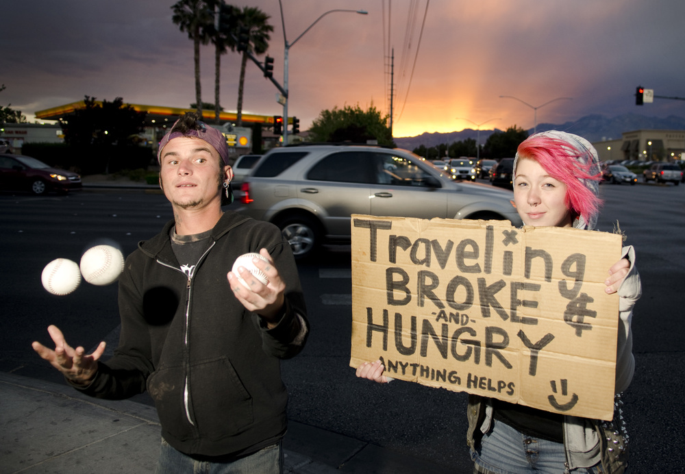 Panhandlers pose for a semi-candid portrait at Charleston and Rampart in Las Vegas, Nevada.
