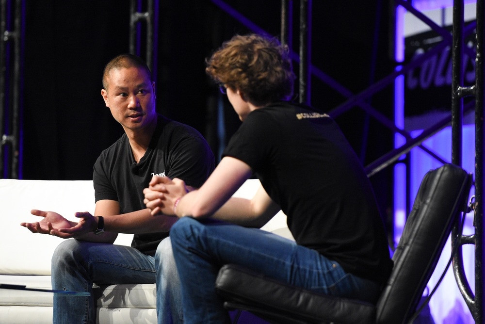 Tony Hsieh (left) founder of Zappos.com, shares the Zappos story with Paddy Cosgrave (right), founder of Collision Conference, on Center Stage.