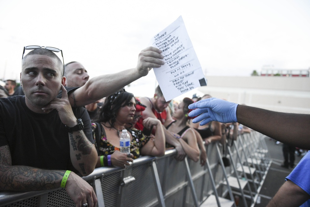 Security passes Agnostic Front's set list to an audience member after the bands  set at Punk Rock Bowling in downtown Las Vegas, Nevada.