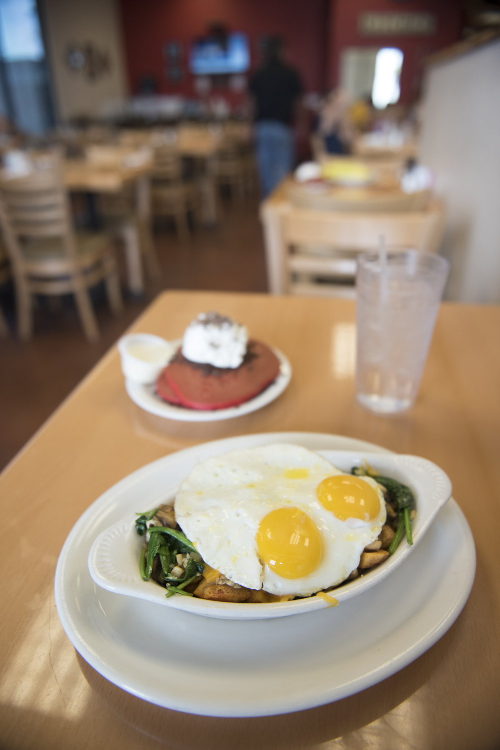 The Baby Chick Skillet, front, and Red Velvet Pancakes are shown at BabyStacks in Henderson, Friday, June 26, 2015.(Jason Ogulnik/Las Vegas Review-Journal)