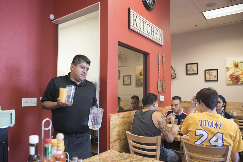 Restaurant manager, Efrain Joachin, brings food to customers at BabyStacks in Henderson, Friday, June 26, 2015.(Jason Ogulnik/Las Vegas Review-Journal)