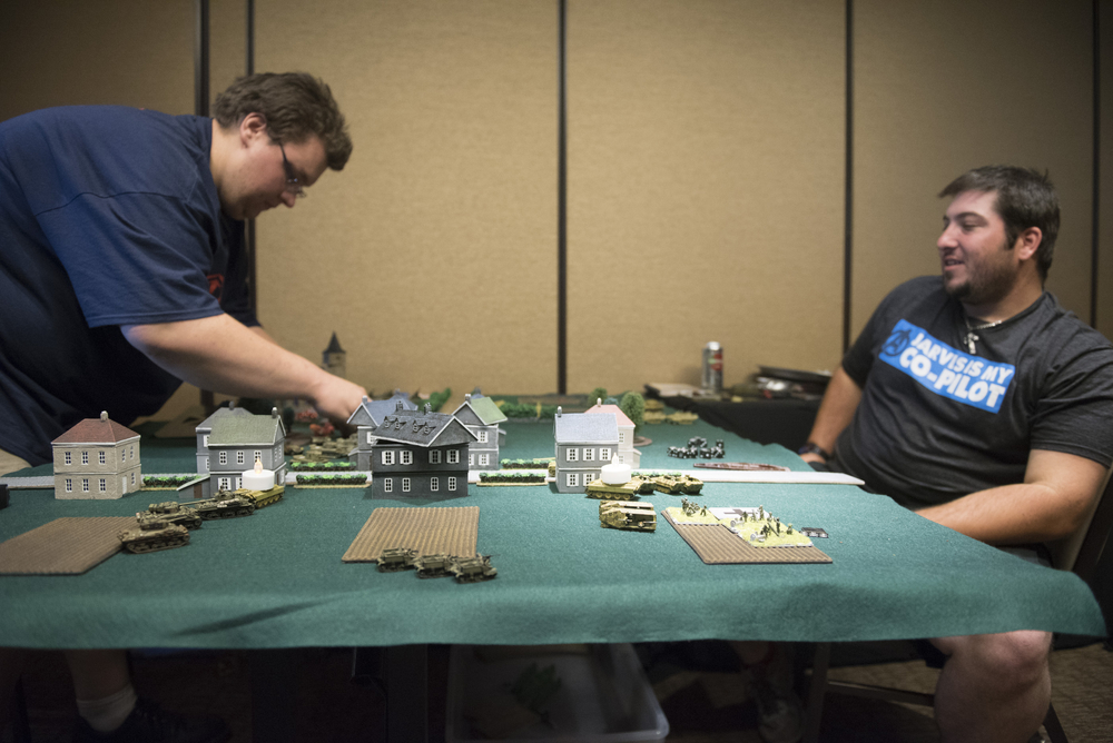 Stephen Armellino, left, plays in the Flames Of War Tournament against Garret Schummer, right, at CombatCon at The Palms Resort and Casino in Las Vegas, Saturday, June 27, 2015.(Jason Ogulnik/Las Vegas Review-Journal)
