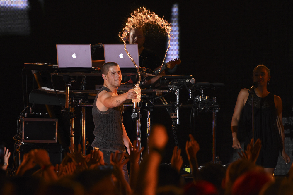Nick Jonas douses the audience with water at the iHeartRadio Summer Pool Party at Caesars Palace in Las Vegas on Saturday, May 30. (Jason Ogulnik/Las Vegas Review-Journal)