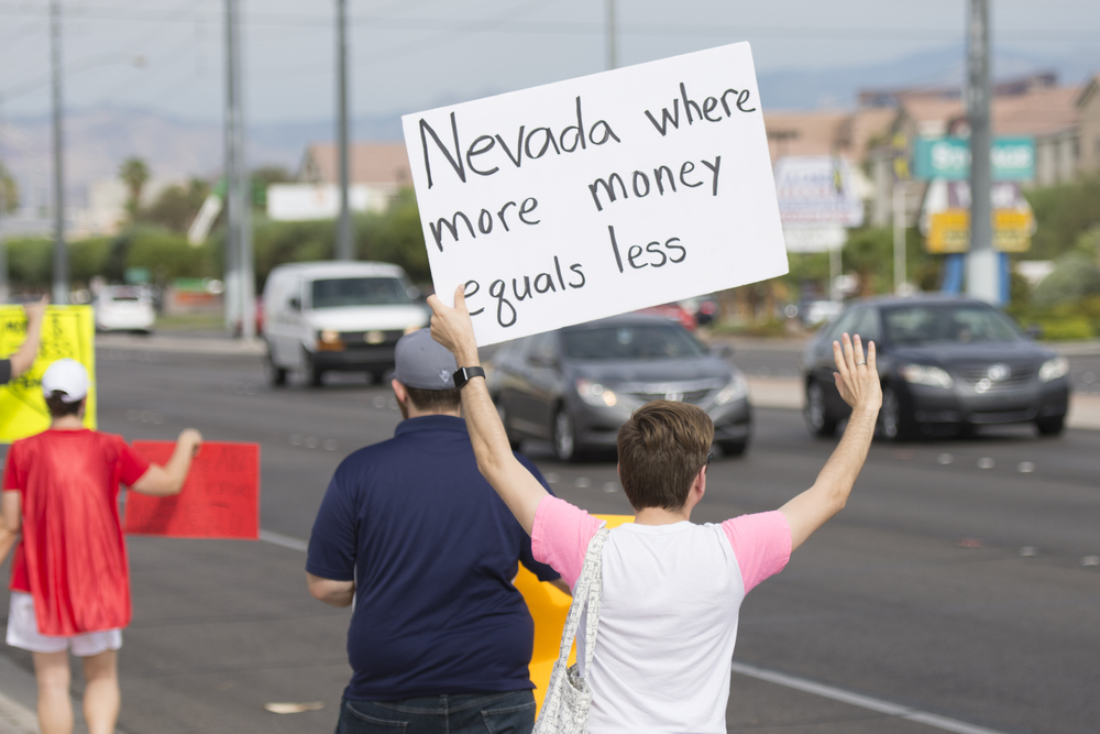 Clark County School District teachers picket outside of CCSD's Education Center in Las Vegas, Thursday, July 2, 2015.(Jason Ogulnik/Las Vegas Review-Journal)