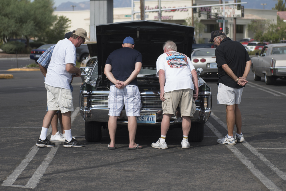 Attendees look under the hood of a car at the West End Boys car gathering in the Vons parking lot at 6000 West Cheyenne Avenue in Las Vegas, Sunday, July 5, 2015.(Jason Ogulnik/Las Vegas Review-Journal)