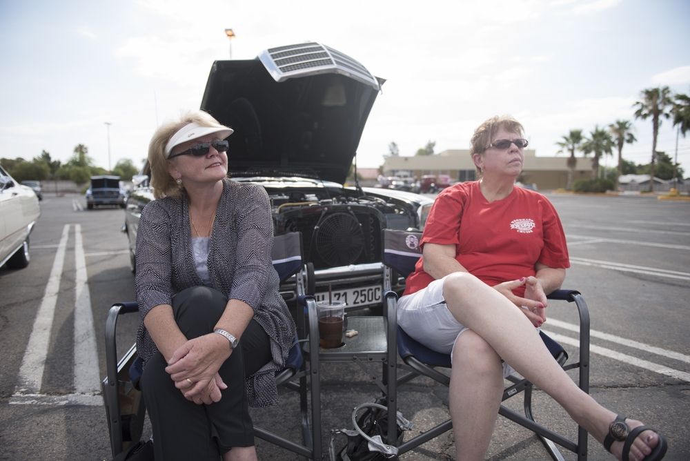 Barbara Benson, left, and Cathy Kunkle, hang out in front of Benson's 1971 Mercedes-Benz 250 coupe at the West End Boys car gathering in the Vons parking lot at 6000 West Cheyenne Avenue in Las Vegas, Sunday, July 5, 2015.(Jason Ogulnik/Las Vegas Review-Journal)