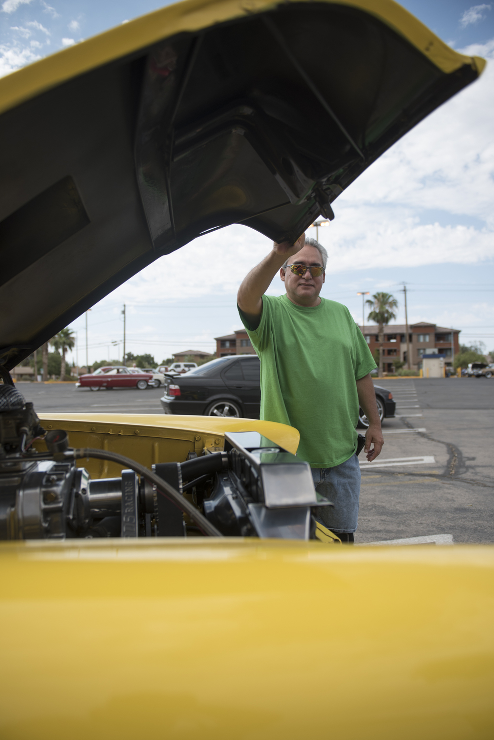 Les Rodriques poses for a photo with his car at the West End Boys car gathering in the Vons parking lot at 6000 West Cheyenne Avenue in Las Vegas, Sunday, July 5, 2015.(Jason Ogulnik/Las Vegas Review-Journal)