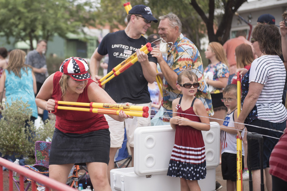 Many of the Fourth of July parade spectators take part in a watertight along 5th street during the 67th Annual Boulder City Damboree Celebration in Boulder City, Saturday, July 4, 2015.(JASON OGULNIK/BOULDER CITY REVIEW)